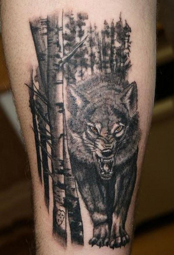 腿部黑灰愤怒的狼和森林纹身图案