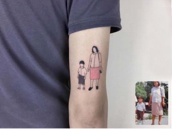 纹身照片 男生手臂上彩色的照片纹身图片
