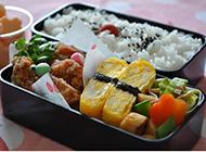 创意美味的午餐米饭便当图片