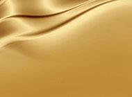 金色漂亮布料的ppt背景图片
