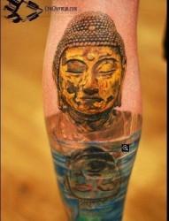 腿部经典的一张佛头铜像纹身图片