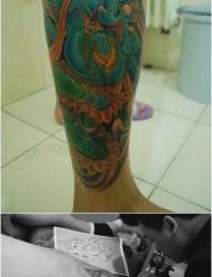 腿部前卫很帅的一张传统象神纹身图片