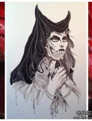 流行很酷的一张美女恶魔纹身图片