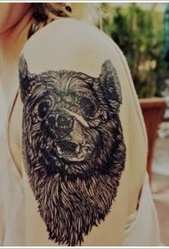 大臂黑色的熊头纹身图案