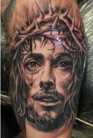 手臂美丽的写实荆棘冠流泪耶稣纹身图案