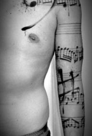 手臂黑色五线谱与音符纹身图案