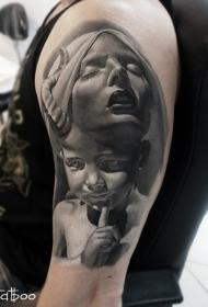 肩部石雕风格的魔鬼孩子纹身图案
