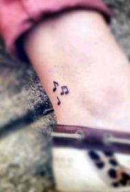 脚踝骨纹身 女生脚踝上黑色的音符纹身图片