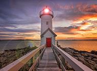 灯塔海岸夕阳与夜景风景图片