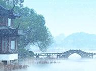 杭州西湖冬天雪花纷飞美景图片