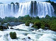 绿树环绕山间瀑布溪流风景图片