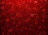 唯美雪花飘红色背景图片