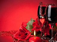 浪漫婚庆红玫瑰红酒与红蜡烛图片素材