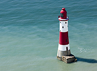 唯美大海红白灯塔背景图片