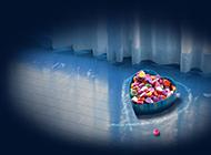 彩色爱心糖果盒蓝色背景素材