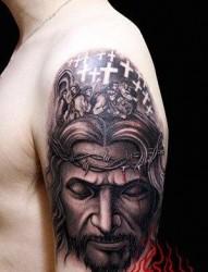 大臂经典前卫色耶稣肖像纹身图片
