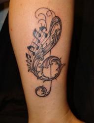 小腿部漂亮的音符纹身