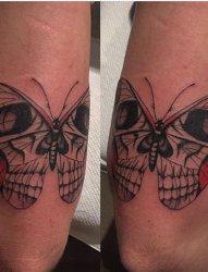 手臂上的骷髅蝴蝶纹身图片