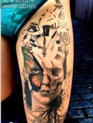 大腿上一张个性时尚的骷髅纹身图案