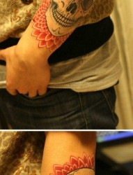 手臂时尚潮流的骷髅纹身图案