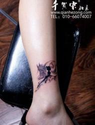 女孩子腿部精灵纹身图片