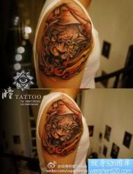 男生手臂霸气的唐狮子纹身图片