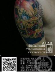 男生手臂很帅经典的唐狮子纹身图片