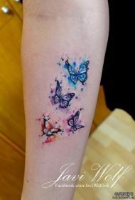 小臂泼墨彩色一群蝴蝶纹身图案