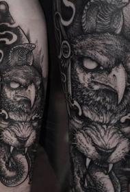 雕刻风格黑色鹰与恶魔狮子手臂纹身图案