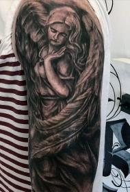 手臂悲伤天使和大羽毛纹身图案