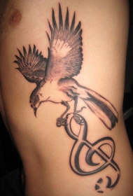 展翅的小鸟和音符纹身图案