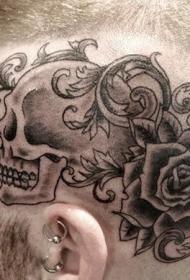 头部黑色卡通风格骷髅与玫瑰纹身图案