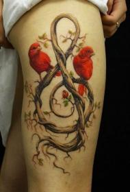 大腿黑色的小鸟和高音符号藤蔓纹身图案