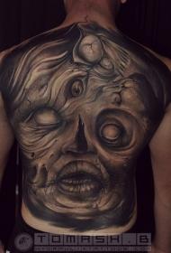 背部黑色神秘的怪物脸纹身图案