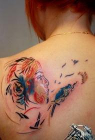 背部彩色的女子脸纹身图案
