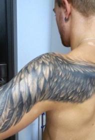 肩部简单设计的黑白翅膀纹身图案