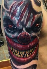手臂彩色恐怖风格魔鬼小丑脸纹身图案