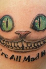 绿眼睛的猫和字母纹身图案