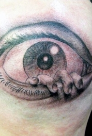 头部可怕的黑色眼睛与手纹身图案