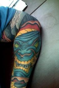 手臂可怕的蓝色笑脸怪物纹身图案