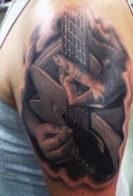 大臂写实的黑灰音乐家与吉他纹身图案