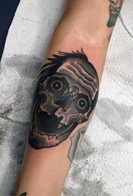 手臂滑稽的卡通怪物头和蓝色眼睛纹身图案