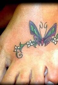 蝴蝶和白色小花脚背纹身图案