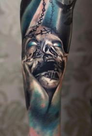 小臂彩色恐怖风格怪物脸纹身图案