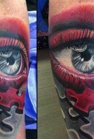 手臂华丽的彩色眼睛与拼图块纹身图案