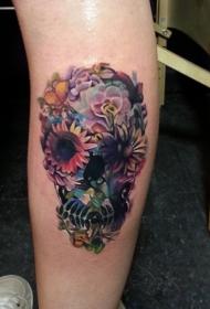 腿上漂亮的花朵骷髅纹身图案