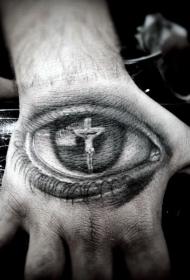 手背眼睛内映出耶稣在十字架上纹身图案