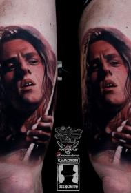 腿部彩色肖像风格的著名吉他手纹身