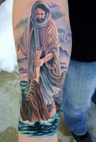 手臂彩色的宗教主题纹身图案