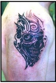 肩部黑色怪兽头骨图腾纹身图案